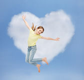 Smiling little girl jumping. Happiness, activity and child concept - smiling little girl jumping Royalty Free Stock Photos
