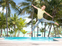 Smiling little girl jumping Stock Photography