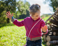 Smiling little girl keeps her balance Royalty Free Stock Images