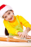 Smiling little girl kneading for Christmas cooking Royalty Free Stock Images