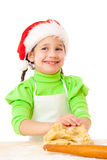 Smiling little girl kneading for Christmas cooking Royalty Free Stock Photos