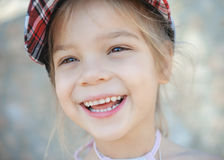 Smiling little girl in knitted cap Royalty Free Stock Images