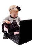 Smiling little girl with laptop Stock Photos