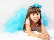 Smiling Little Girl Laying Royalty Free Stock Image