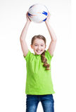 Smiling little girl lifted up the ball. Royalty Free Stock Photography
