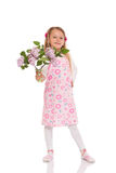 Smiling little girl with lilac flowers Stock Images
