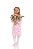 Smiling little girl with lilac flowers Royalty Free Stock Photos