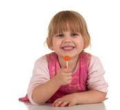 Smiling little girl with lollipop Stock Photography