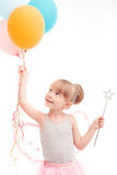 Smiling little girl looking at balloons Stock Photos