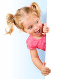 Smiling little girl looking Stock Images