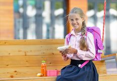 Smiling little girl with lunch stock image