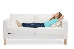 Smiling little girl lying on sofa stock image