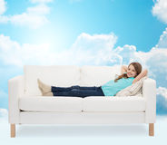 Smiling little girl lying on sofa Royalty Free Stock Image