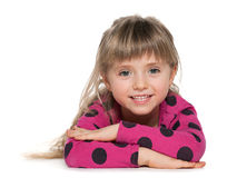 Smiling little girl is lying on the white Stock Photos