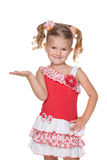 Smiling little girl makes a hand gesture. A smiling little girl makes a hand gesture against the white background Royalty Free Stock Image
