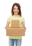 Smiling little girl with many cardboard boxes Royalty Free Stock Photos