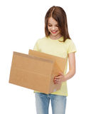 Smiling little girl with many cardboard boxes Royalty Free Stock Image