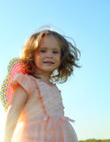 Smiling little girl on meadow Royalty Free Stock Photography