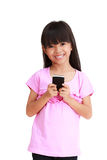 Smiling little girl with mobile phone Stock Images