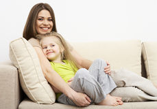 Smiling little girl with mother Stock Photo