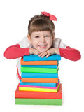 Smiling little girl near books Stock Photos