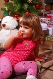 Smiling little girl near the Christmas tree Stock Photos