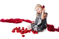 Smiling  little girl with new year toys Royalty Free Stock Photos