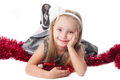 Smiling little girl with new year toys Royalty Free Stock Images