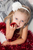 Smiling  little girl with new year toys Stock Photography
