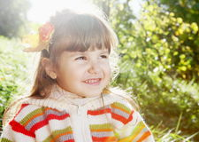 Smiling Little Girl Outdoors on Sunny Day Stock Photo