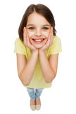 Smiling little girl over white background Stock Photos