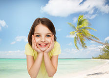Smiling little girl over white background Stock Photography