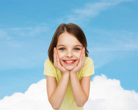 Smiling little girl over white background Royalty Free Stock Photo