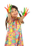Smiling little girl with painted hands Royalty Free Stock Photography
