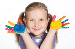 Smiling little girl with painted hands Royalty Free Stock Images