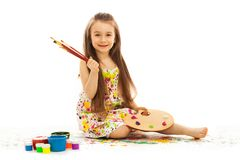 Smiling little girl painting Stock Image