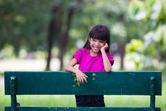 Smiling little girl at park Stock Photography