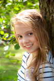 Smiling little girl in park Royalty Free Stock Photography