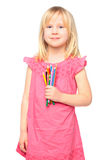 Smiling little girl with pencil royalty free stock photography