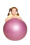 Smiling little girl with pigtails and fitness ball. Stock Images