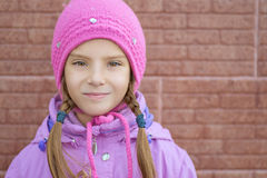 Smiling little girl in pink coat Stock Photography