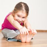 Little girl engaged in fitness Royalty Free Stock Image