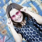 Smiling little girl with pink glasses Stock Photography