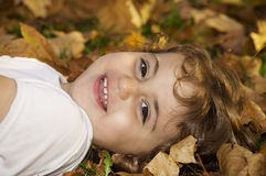 Smiling little girl playing in Autumn Royalty Free Stock Photo