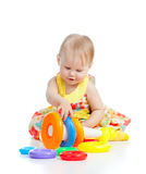 Smiling little girl playing with color toy Royalty Free Stock Images