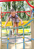 Smiling little girl playing on playground equipment Royalty Free Stock Photo
