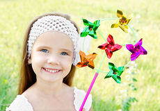 Smiling little girl playing with windmill toy Stock Image