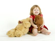 The smiling little girl with plush toys. Stock Photography