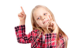Smiling little girl pointing at something Royalty Free Stock Photography