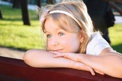 Smiling little girl portrait at a park Stock Photo